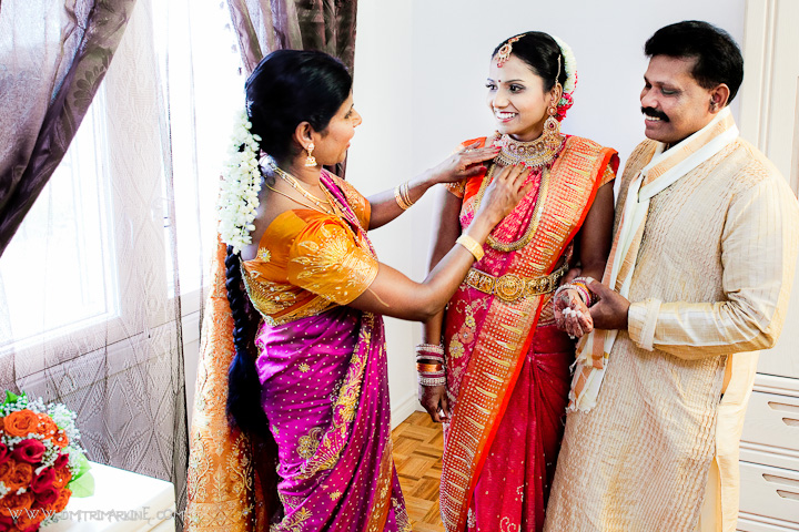 bride with her mother and father during getting ready