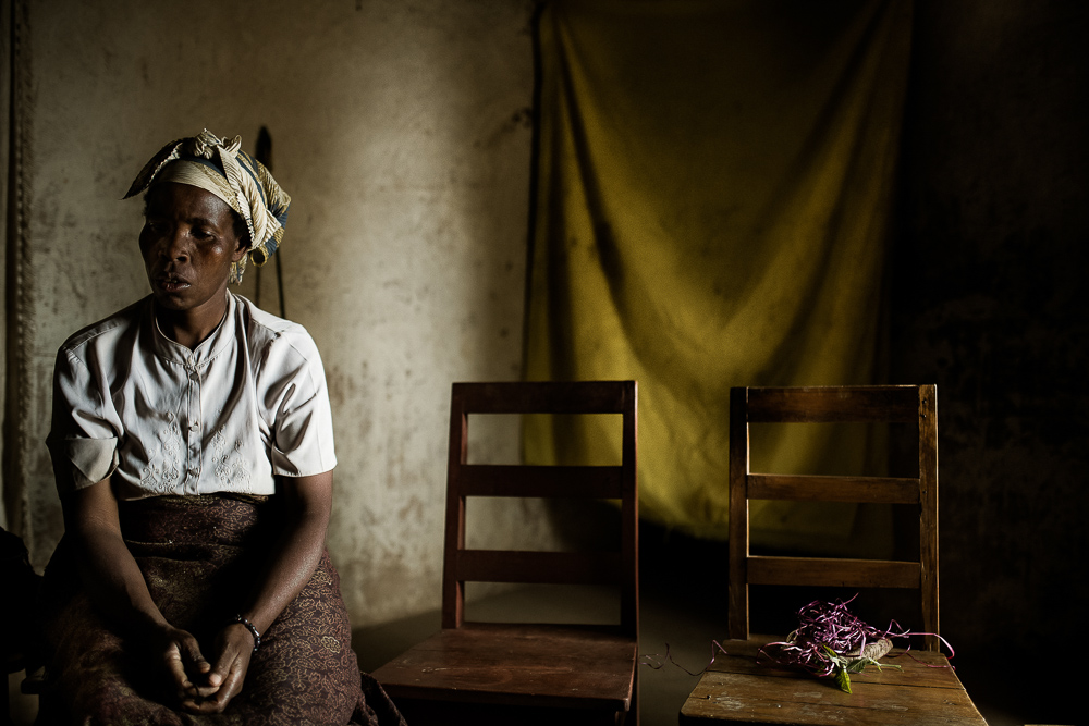 woman sitting inside her house in Uganda