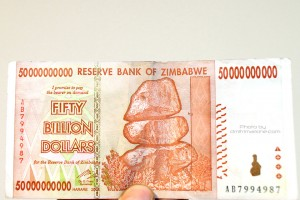 In case you've never seen it, here's $50 BILLION dollars from Zimbabwe.   You'd think you can buy a country with it,yet this is barely enough to buy an egg...
