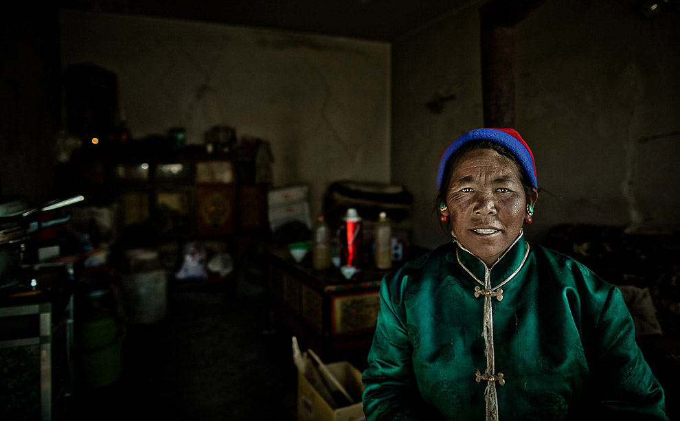portrait of a Tibetan woman with red cheeks